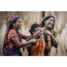 The women of the village also  participate in the Narkel khela just for enjoyment and for the coconuts.