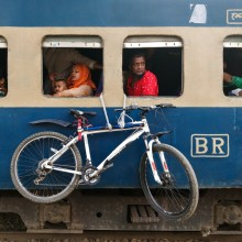 Train Journey of a bicycle|||Passengers and the a bicycle waiting to start a journey at Uttara railway station,Dhaka,Bangladesh