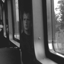 We are now strangers|||An accidental fellow-travellers at a carriage of train. Sometime, somewhere on the Russian railways. The image of a young man is a reflection on the car wall.<br /> <br /> The picture was taken by smartphone's camera NOKIA N8.